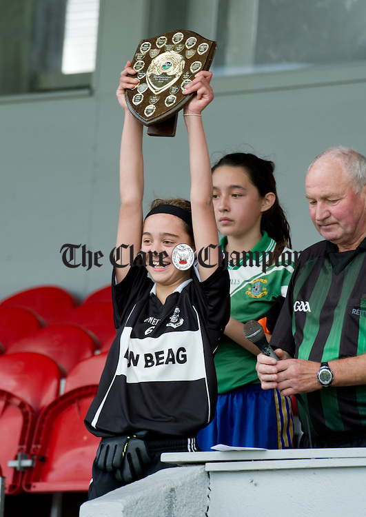 Bansha/Clohanes captain Keara Wealleans lifts the shield following their win over Stonehall NS in Division 3 at the Cumann na mBunscoil Finals in Cusack Park. Photograph by John Kelly.
