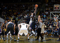 Robert Thurman of California tips off against Aziz N'Diaye of Washington during the game at Haas Pavilion in Berkeley, California on January 9th, 2013.   Washington defeated California, 62-47.