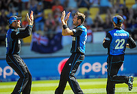 Martin Guptill congratulates Tim Southee on a wicket during the ICC Cricket World Cup one day pool match between the New Zealand Black Caps and England at Wellington Regional Stadium, Wellington, New Zealand on Friday, 20 February 2015. Photo: Dave Lintott / lintottphoto.co.nz