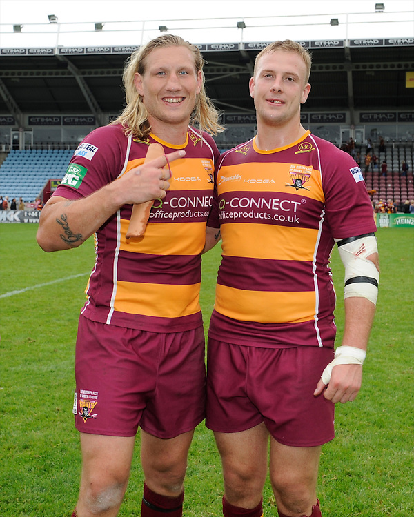 Eorl Crabtree (left) and Craig Kopczak of Huddersfield Giants celebrate winning the Super League match between Huddersfield Giants and London Broncos at The Twickenham Stoop on Saturday 17th August 2013 (Photo by Rob Munro)