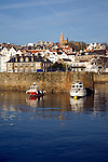 Boats in the harbour and the town of St Peter Port, Guernsey, Channel Islands, UK