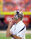 September 18 - Champaign, Illinois, USA -  Illinois Coach Ron Zook communicates with his coaching staff in the game between the University of Illinois Fighting Illini and the Northern Illinois University Huskies at Memorial Stadium.  The Illini defeated the Huskies 28 to 22.