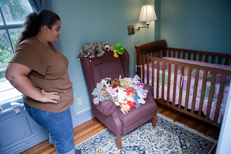 """I have six children and five TPR's (Terminated Parental Rights)...I'm not a model mother,"" Brandi said.  As a resident of The Mother-Child Reunification House program at Amos House in Providence, Rhode island, she prepares for the first unsupervised overnight visit she will have with her infant daughter, Patience. Brandi is one of a group of women taking part in a new program which is using a different approach to reuniting mothers with their children.  The program combines life skill training, counseling and treatment in a safe and supportive longterm residential home.  For Brandi, this is a chance to change her life and gain custody of her youngest child, the only one not taken permanently by Rhode Island State Child Protective Service. <br />