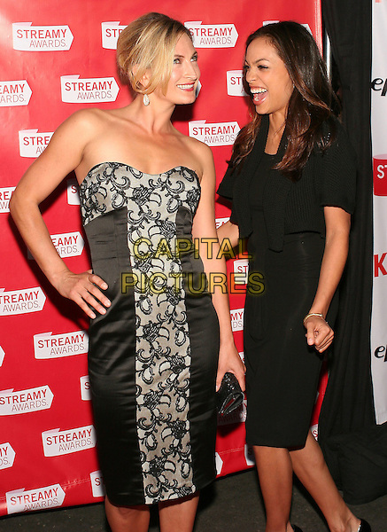 ZOE BELL & ROSARIO DAWSON.First Annual Streamy Awards Honoring Excellence in Original, Professionally Produced Web Television Programming held at the Wadsworth Theatre, Los Angeles, California, USA..March 28th, 2009.half 3/4 hand on hip mouth open laughing funny length black dress silk satin clutch bag  strapless grey gray lace.CAP/ADM/TC.©T. Conrad/AdMedia/Capital Pictures.