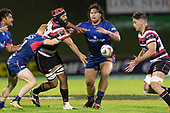Matiaha Martin gets  his pass away to Sam Henwood. Mitre 10 Cup game between Counties Manukau Steelers and Tasman Mako's, played at ECOLight Stadium Pukekohe on Saturday October 14th 2017. Counties Manukau won the game 52 - 30 after trailing 22 - 19 at halftime. <br /> Photo by Richard Spranger.