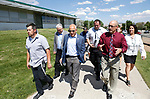 Officials from Hug High School in Reno, Nev., give Raiders president Marc Badain, center, a tour of the campus on Thursday, Aug. 16, 2018. The Raiders are considering several potential training camp locations in Reno. (Cathleen Allison/Las Vegas Review-Journal)