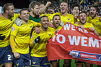 The Oxford United players celebrate reaching the Wembley final during the Johnstone's Paint Trophy Southern Final 2nd Leg match between Oxford United and Millwall at the Kassam Stadium, Oxford, England on 2 February 2016. Photo by Andy Rowland / PRiME Media Images.