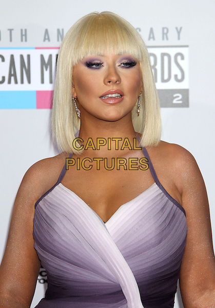 Christina Aguilera.40th Anniversary American Music Awards - Arrivals held at Nokia Theatre L.A. Live, Los Angeles, California, USA..November 18th, 2012.AMA AMAs headshot portrait purple halterneck fringe bangs hair make-up eyeshadow half length.CAP/ADM/RE.©Russ Elliot/AdMedia/Capital Pictures.