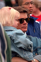Dad holding daughter age 38 and 2 at Vietnam Wall on Memorial Day. St Paul Minnesota USA