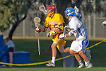 Rancho Santa Margarita, CA 04/30/10 - Spencer Brewster (Torrey Pines #25) and Frankie Berry (Santa Margarita #21) in action during the Rancho Santa Margarita CHS-Torrey Pines boys varsity lacrosse game.
