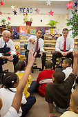 Chicago, Il - December 16, 2008 -- United States President-elect Barack Obama, center, calls on a student as he and newly nominated Secretary of Education former Chicago School Chief Arne Duncan, right, and Vice President-elect Joseph Biden, left speak to schoolchildren at Dodge Renaissance Academy on Chicago's West Side on Tuesday, December 16, 2008..Credit: Ralf-Finn Hestoft - Pool via CNP