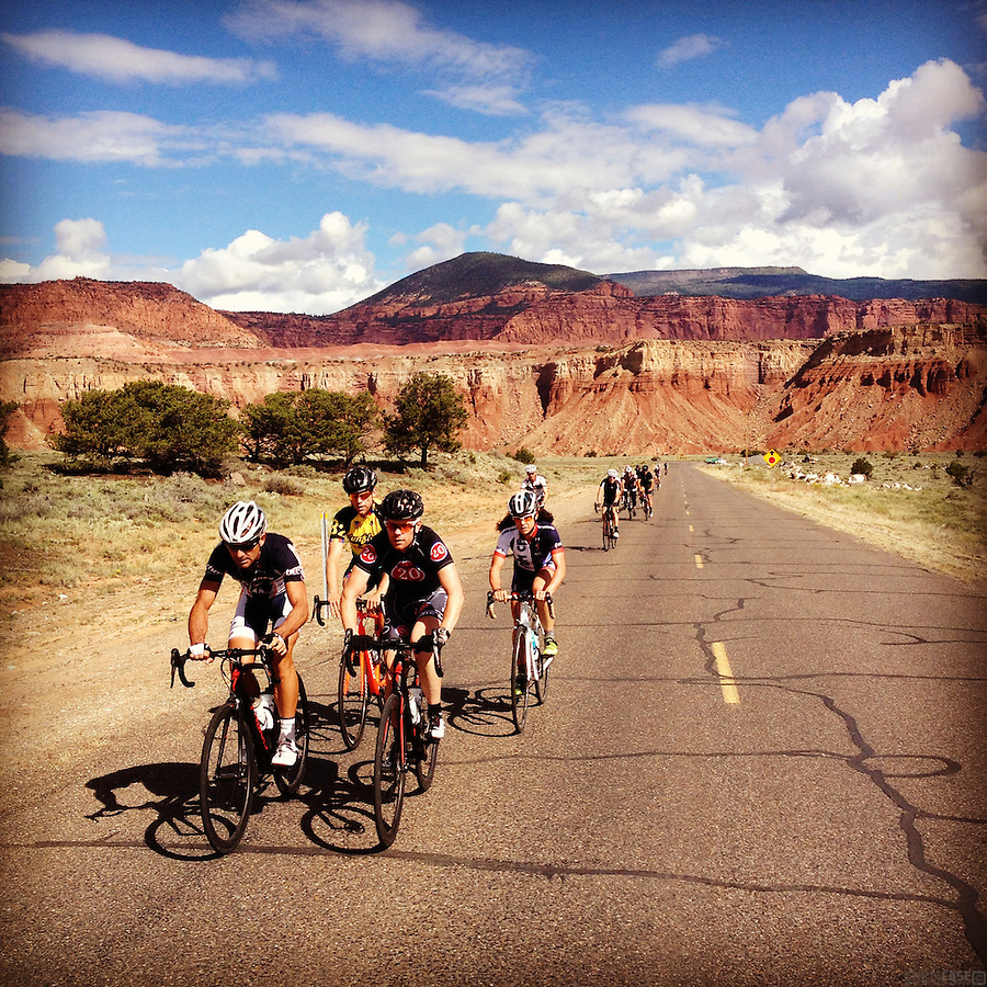 A group of cyclists climbs above the bluffs outside of Torrey, Utah.