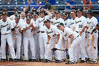 The Wake Forest Demon Deacons await the arrival of teammate Ben Breazeale (not pictured) following his game winning 2-run home run in the bottom of the 11th inning against the Florida Gators in the completion of Game Two of the Gainesville Super Regional of the 2017 College World Series at Alfred McKethan Stadium at Perry Field on June 12, 2017 in Gainesville, Florida.  The Demon Deacons walked off the Gators 8-6 in 11 innings. (Brian Westerholt/Four Seam Images)