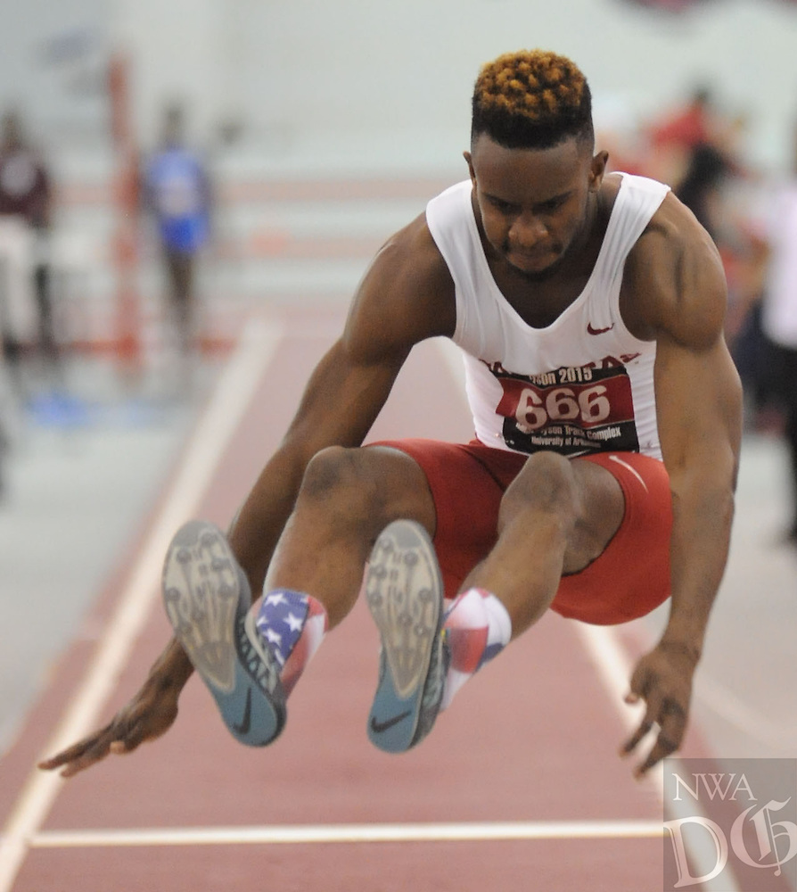 NWA Democrat-Gazette/ANDY SHUPE - Jarrion Lawson of Arkansas competes in the long jump during the Tyson Invitational Friday, Feb. 13, 2015, at the Randal Tyson Track Center in Fayetteville.