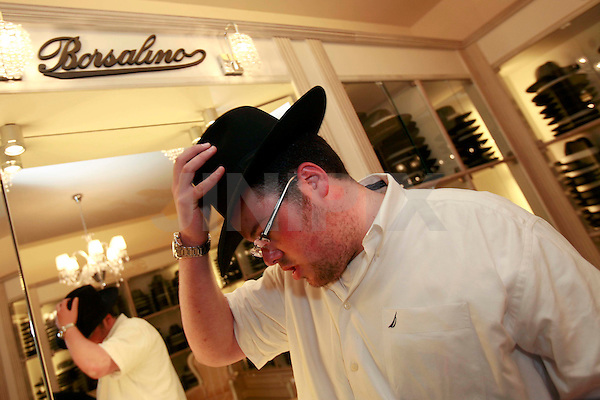 An Ultra Orthodox Jew is seen shopping in a Borsalino hat shop in the Jerusalem orthodox neighborhood of Mea Shearim, Thursday, April 23, 2009. Photo By: Olivier Fitoussi / JINI