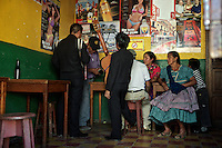 The musical duo made of a bandoneon and a guitar in charge of the still a kid Cristian, just finished serenading a couple in the local bar.  ..Bar La Copa, 3a Calle Poniente #27, La Antigua, Guatemala. ..El duo musical compuesto por un bandoneón y una guitarra a cargo del niño Cristian, acaba de terminar de serenar a una pareja en el bar.