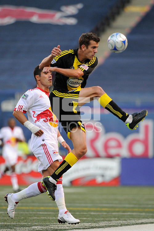 Eric Brunner (23) of the Columbus Crew clears the ball away from Juan Pablo Angel (9) of the New York Red Bulls. The New York Red Bulls defeated the Columbus Crew 1-0 during a Major League Soccer match at Giants Stadium in East Rutherford, NJ, on August 30, 2009.