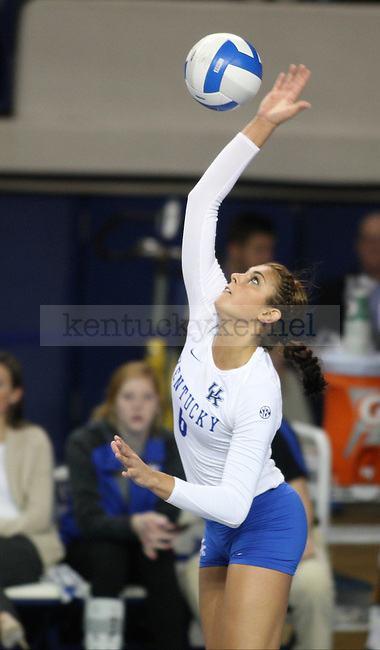 Sophomore Morgan Bergren jumps to hit the ball during the UK vs. LSU women's volleyball game at Memorial Coliseum in Lexington, Ky., on Sunday, November 10, 2013. UK won the set 3-2. Photo by Tessa Lighty | Staff