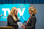 Wyandanch, New York, USA. March 26, 2017. L-R, SUE MOLLER, an administrator of Together We Will Long Island, introduces and shakes hands with LAURA CURRAN, Nassau County Legislator (Dem. - District 5), who is about to speak at Politics 101 event, the first of series of activist workshops for members of TWW LI, the Long Island affiliate of national Together We Will. Curran is a Democratic candidate for Nassau County Supervisor.