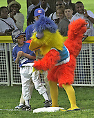 The San Diego Chicken gives base running advice to a member of the Satchell Paige Little League Memphis Red Sox during the first T-Ball game on the South Lawn of the White House in Washington, DC on May 6, 2001.<br /> Credit: Ron Sachs / CNP