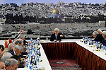Palestinian President Mahmoud Abbas sits in front of a picture of the Dome of the Rock mosque in Jerusalem's Old City during a meeting of the Palestinian leadership in the West Bank city of Ramallah on March 19, 2018. Photo by Osama Falah