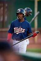 Elizabethton Twins designated hitter Yunior Severino (22) walks back to the dugout during a game against the Bristol Pirates on July 28, 2018 at Joe O'Brien Field in Elizabethton, Tennessee.  Elizabethton defeated Bristol 5-0.  (Mike Janes/Four Seam Images)