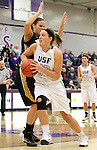 SIOUX FALLS, SD - DECEMBER 6:  Laura Johnson #32 from the University of Sioux Falls drives against Shantel Lehmann #54 from Wayne State in the first half of their game Friday night at the Stewart Center. (Photo by Dave Eggen/Inertia)