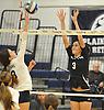 Massapequa No. 3 Joie Landy, right, defends against a spike attempt by Plainview JFK No. 8 Jillian Lambert during a Nassau County varsity girls' volleyball matchat Plainview JFK High School on Monday, October 19, 2015. Massapequa won 25-16, 25-8, 25-13.<br /> <br /> James Escher