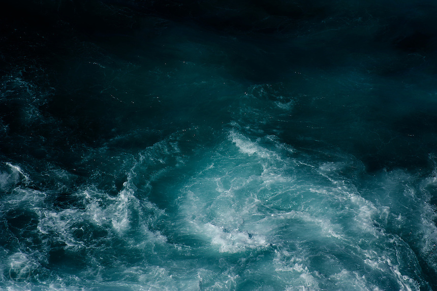 Detail of the turbulent tide changes in the blue ocean off the rocks between Bondi and Coogee, Sydney, Australia.