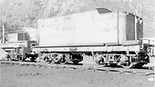 Side-end view of tender type water car #W493 (ex C-16 tender #206) at Durango.  Partial end view of Flanger OD.<br /> D&amp;RGW  Durango, CO  Taken by Maxwell, John W. - 5/30/1959
