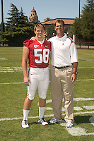 STANFORD, CA - AUGUST 10: Jeff Bowlsby of the Stanford Cardinal poses with the head coach during picture day on August 10, 2008 at Elliott Field in Stanford, California.
