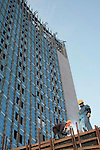 ADDIS ABABA, ETHIOPIA - NOVEMBER 17:  A Chinese construction worker with an Ethiopian worker at the new African Union Buildings on November 17, 2010 in Addis Ababa, Ethiopia. The building is built for free. Chinese companies are investing and working all over Africa and in Ethiopia they are mainly occupied with infrastructure projects around the country. Photo by: Per-Anders Pettersson