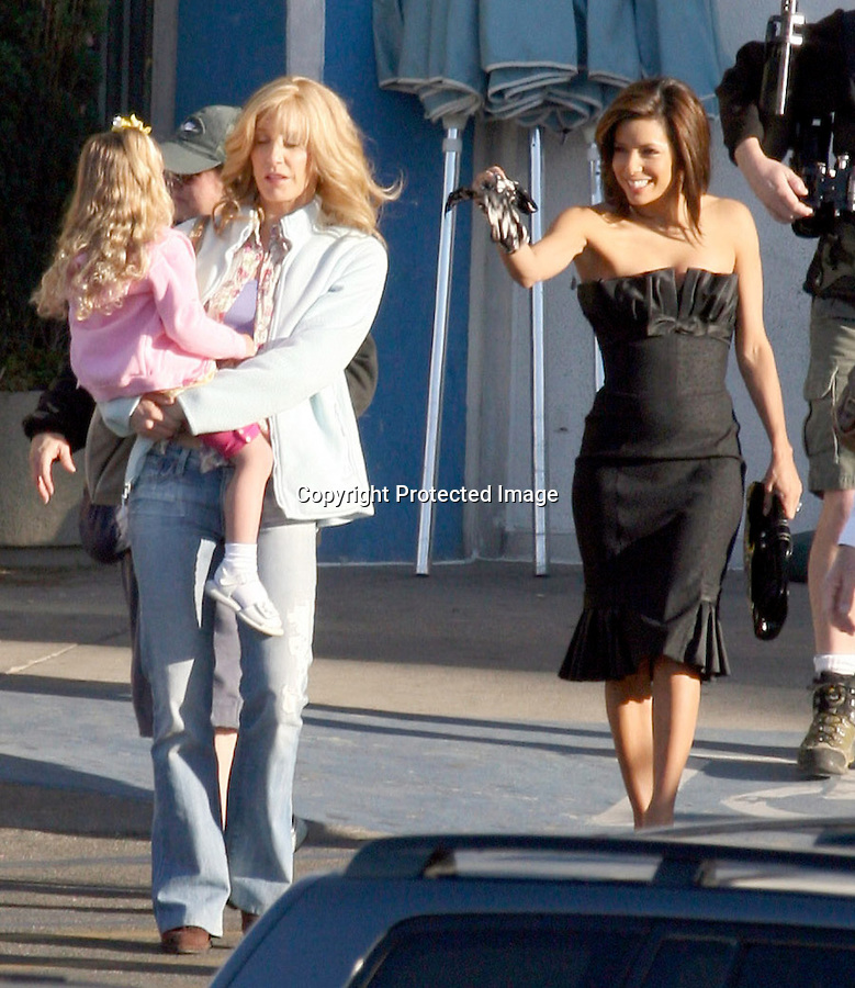 3-10-08   Exclusive..Eva Longoria filming the TV.show Desperate HOusewives.with Felicity Huffman in Los .Angeles California. You can see.Felicty huffman wears a wig .for the show. ..AbilityFilms@yahoo.com.805-427-3519.www.AbilityFilms.com