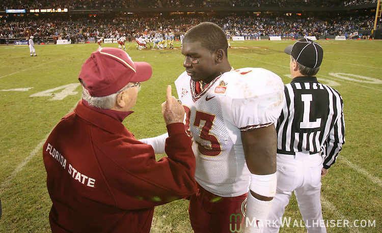 As the game winds down, Florida State head coach Bobby Bowden, left, gives some advice to linebacker Lawrence Timmons in the Emerald Bowl at AT&T Park in San Francisco, California December 27, 2006.  .