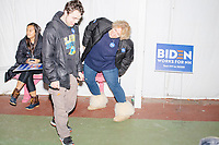 A woman stretches before leaving after Democratic presidential candidate and former Vice President Joe Biden spoke a campaign event at The Sports Barn in Hampton, New Hampshire, on Sun., December 8, 2019.