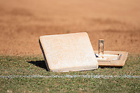 A couple of bases sit on the grass prior to the NCAA Division II baseball game between the Shippensburg Raiders and the Belmont Abbey Crusaders at Abbey Yard on February 8, 2015 in Belmont, North Carolina.  The Raiders defeated the Crusaders 14-0.  (Brian Westerholt/Four Seam Images)
