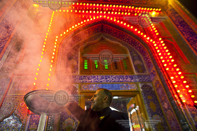 A man stands by an incence burner prior to Ashura during Muharram. Ashura marks the anniversary of the Battle of Kerbala and is a period of intense grief among Shi'ite followers of Islam.