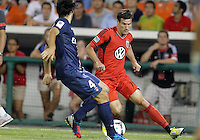 WASHINGTON, DC - July 28, 2012:  Chris Pontius (13) of DC United cuts away from Milan Bisevac (4) of PSG (Paris Saint-Germain) in an international friendly match at RFK Stadium in Washington DC on July 28. The game ended in a 1-1 tie.