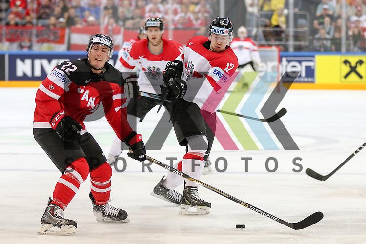 Oestereichs Raffl, Michael (Nr.12) mit einem Schuss gegen Canadas Barrie, Tyson (Nr.22)  im Spiel IIHF WC15 Kanada vs. Oestereich.<br /> <br /> Foto &copy; P-I-X.org *** Foto ist honorarpflichtig! *** Auf Anfrage in hoeherer Qualitaet/Aufloesung. Belegexemplar erbeten. Veroeffentlichung ausschliesslich fuer journalistisch-publizistische Zwecke. For editorial use only.