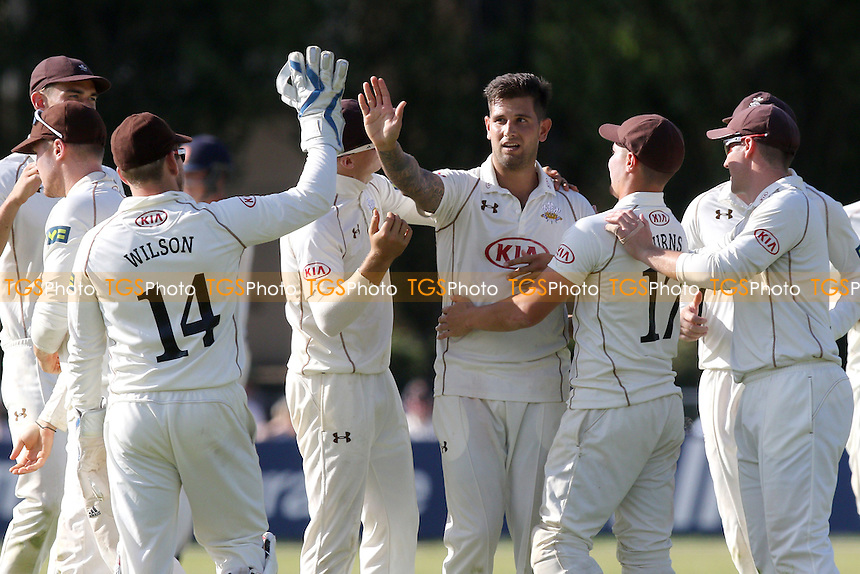 Jade Dernbach of Surrey CCC (C) celebrates taking the wicket of James Foster
