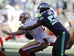 Seattle Seahawks defensive end Cliff Avril (56) sacks San Francisco 49ers quarterback Blaine Gabbert (2) at CenturyLink Field in Seattle, Washington on November 22, 2015.  The Seahawks beat the 49ers 29-13.   ©2015. Jim Bryant Photo. All RIghts Reserved.