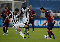 Calcio, finale di Champions League Juventus vs Barcellona all'Olympiastadion di Berlino, 6 giugno 2015.<br /> FC Barcelona's Sergio Busquets, right, is challenged by Juventus' Alvaro Morata during the Champions League football final between Juventus Turin and FC Barcelona, at Berlin's Olympiastadion, 6 June 2015.<br /> UPDATE IMAGES PRESS/Isabella Bonotto