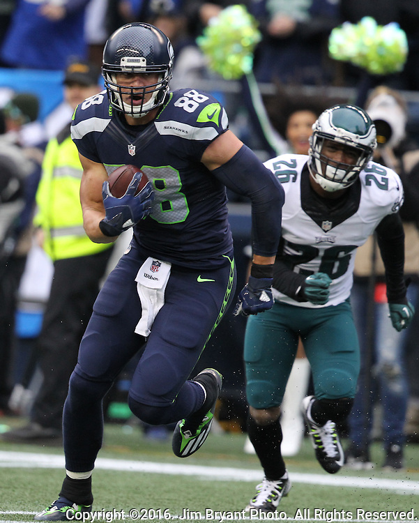 Seattle Seahawks Tight end Jimmy Graham (88) runs after catching a 35-yard touchdown from quarterback Russell Wilson in the second quarter at CenturyLink Field in Seattle, Washington on November 20, 2016.  Seahawks beat the Eagles 26-15.  ©2016. Jim Bryant Photo. All Rights Reserved.