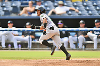 Augusta GreenJackets left fielder Ismael Munguia (6) runs to first base during a game against the Asheville Tourists at McCormick Field on August 19, 2018 in Asheville, North Carolina. The Tourists defeated the GreenJackets 6-3. (Tony Farlow/Four Seam Images)