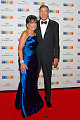 United States Secretary of Commerce Penny Pritzker and her husband, Dr. Bryan Traubert, arrive for the formal Artist's Dinner honoring the recipients of the 38th Annual Kennedy Center Honors hosted by United States Secretary of State John F. Kerry at the U.S. Department of State in Washington, D.C. on Saturday, December 5, 2015. The 2015 honorees are: singer-songwriter Carole King, filmmaker George Lucas, actress and singer Rita Moreno, conductor Seiji Ozawa, and actress and Broadway star Cicely Tyson.<br /> Credit: Ron Sachs / Pool via CNP