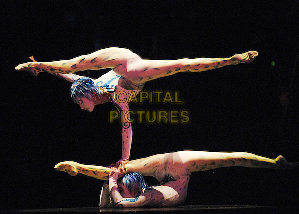 "CIRQUE DU SOLEIL.""Algeria""  show.Royal Albert Hall, Kensington.London England  4th January 2007.duo contorsion: Oyen-Erdene Senge, Ulzibuyan Mergen.full length contortionist .CAP/PL.©Phil Loftus/Capital Pictures"