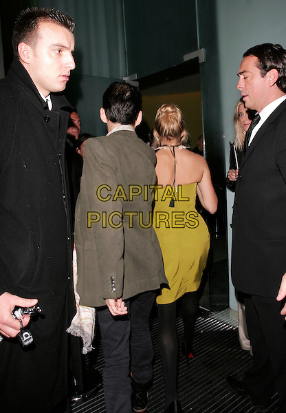 SIENNA MILLER & MATTHEW WILLIAMSON.Matthew Williamson aftershow party at Bungalow 8 (formerly St. martin's Lane Hotel), London, England..September 19th, 2007.full length green yellow dress strapless green jacket back behind rear tassels .CAP/AH.©Adam Houghton/Capital Pictures.