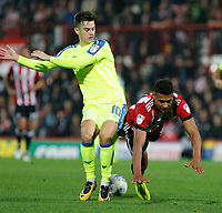 Ollie Watkins of Brentford if felled by Tom Lawrence of Derby County during the Sky Bet Championship match between Brentford and Derby County at Griffin Park, London, England on 26 September 2017. Photo by Carlton Myrie / PRiME Media Images.