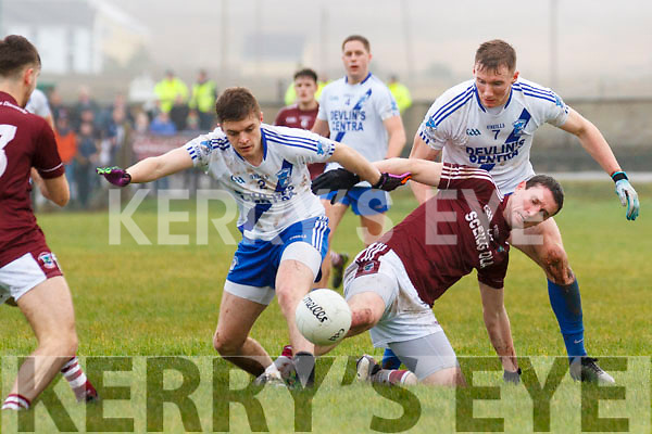 Wet conditions and heavy ground made conditions for the South Kerry Final difficult pictured Dromids Tómas Ó Curráin losing out to the pressure brought by St Marys Killian Nolan & Denis Daly.