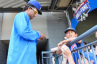 Round Rock pitcher Edwar Cabrera (46) signs autograph for a fan before a baseball game, Saturday May 02, 2015 in Round Rock, Tex. Express defeated Sounds 5-4. (Mo Khursheed/TFV Media via AP images)